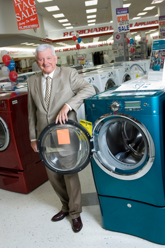 Gary Richard of PC Richard standing by washing machines in one of his stores
